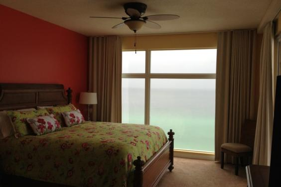 Master Bedroom 1 with outstanding views, floor to ceiling windows & slider to balcony