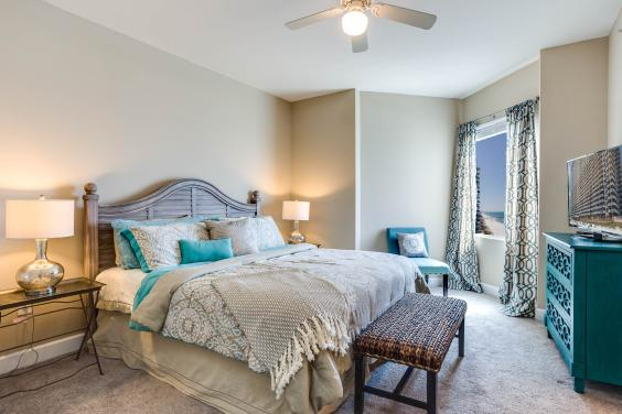 One of two master bedrooms with King size beds in this three bedroom condo