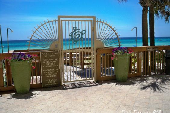 View from pool deck, keypad lock on gate to beach