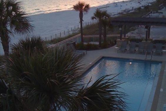 Overlooking One of Two Pools at Sunset from Aqua 207 Balcony
