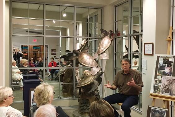 Artist Paul Saviskas explaining his creative process to members of the Center for the Arts