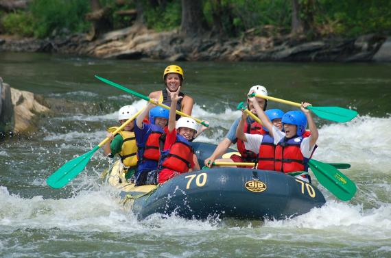 People white water rafting with the River & Trail Outfitters