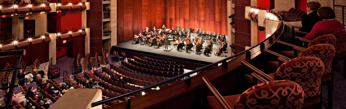 an orchestra on a stage in a theater