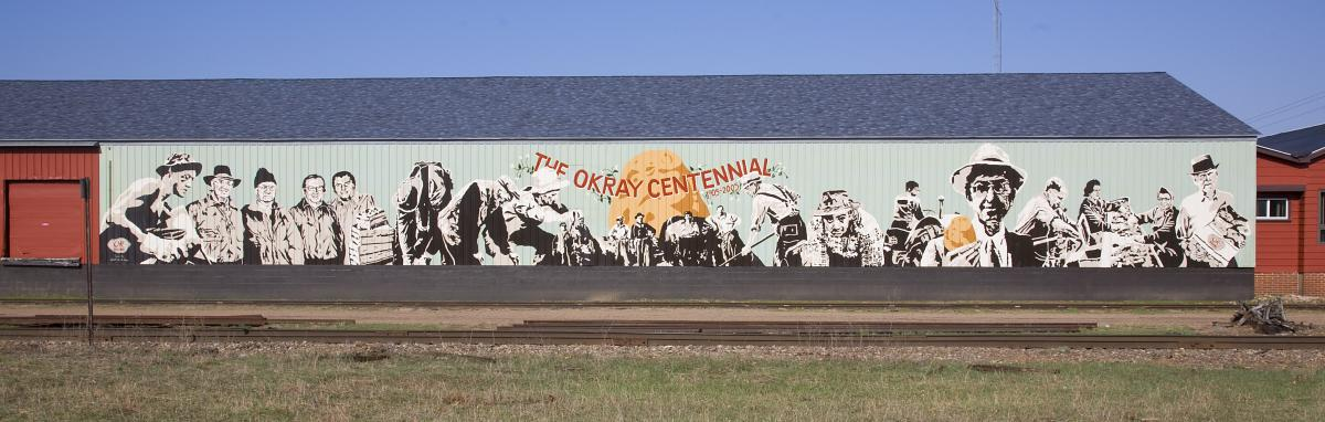 The Okray Family Farms mural in Plover depicts the company's founding fathers and celebrates the company's centennial!