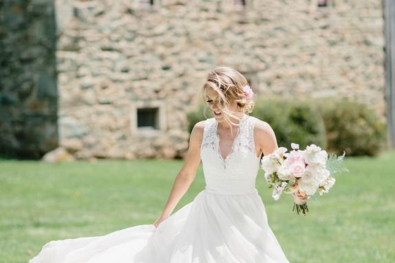 Bride in front of Stone Barn
