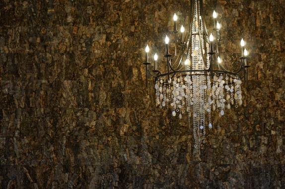 cork wall and chandelier