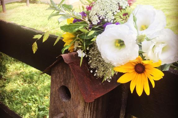 Wedding flowers on birdhouse