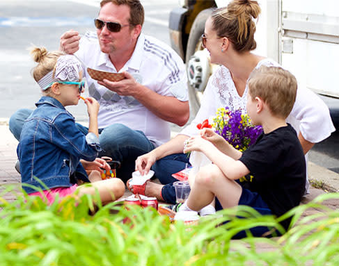 Family Eating at Overland Park Farmers Market
