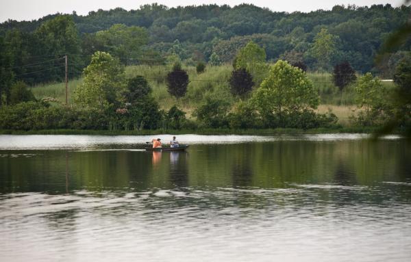 2 men fishing in a canoe at Silver Lake Regional Park