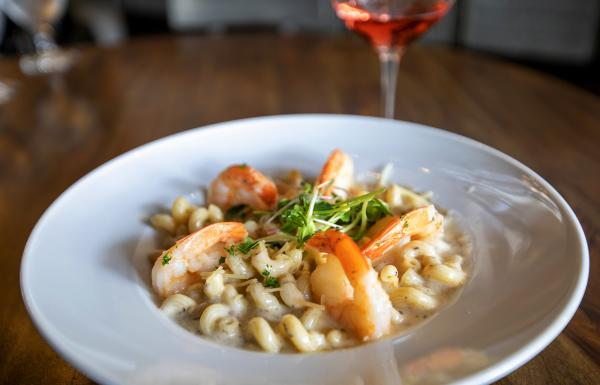 Pasta topped off with shrimp at Vino & Vinyl