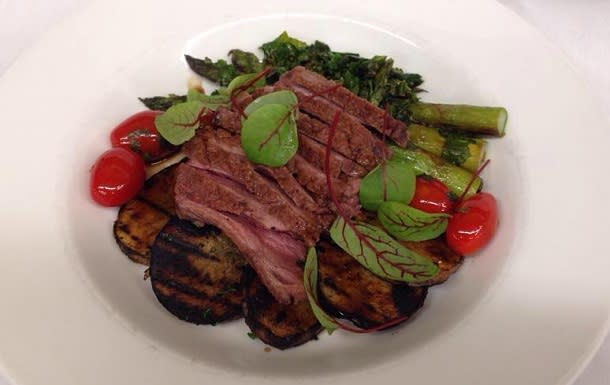 local veggies and steak on plate