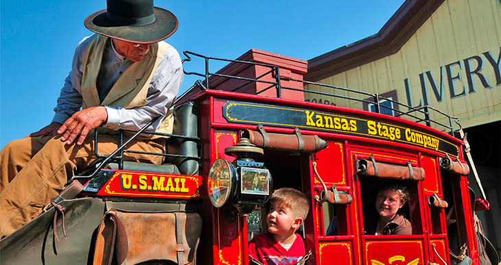 Kids in a stage coach at the Old Cowtown Museum in Wichita