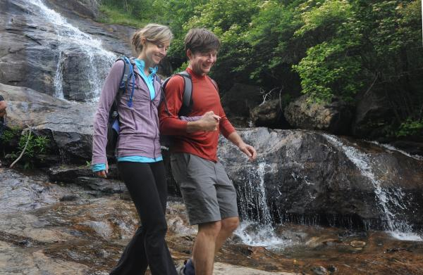 Hikers explore a waterfall in Pisgah National Forest near Asheville, NC