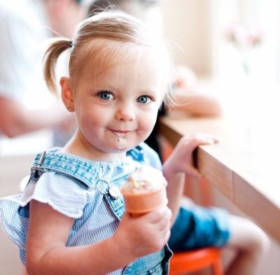 Little girl eating Jeni's Ice Cream Cone