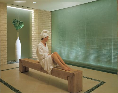 A woman relaxes on a bench at the Four Seasons Spa in Irving, TX.