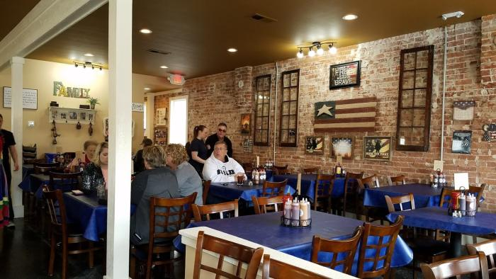 Holy Smoke Hog Roast Company is cozy and decorated in an Americana style.