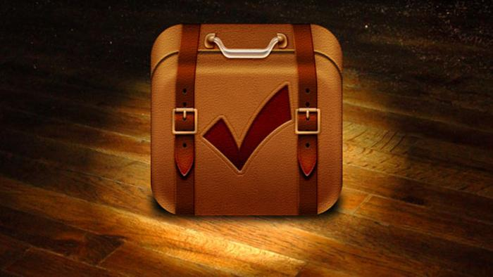 An image of a Travel App shows a suitcase with a check mark on it