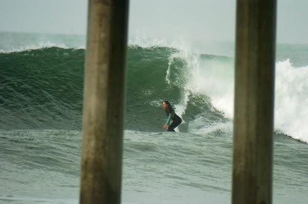 Jamie surfing at the Huntington Beach Pier