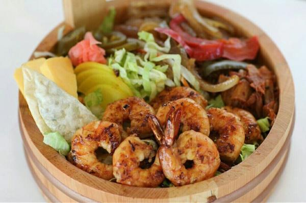 bowl of food with shrimp and vegetables
