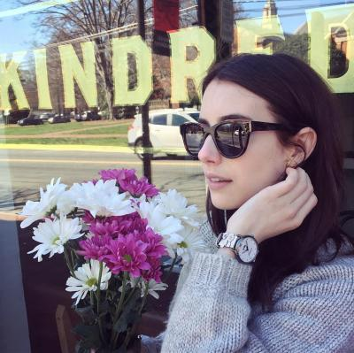 Emma Roberts poses in front of Kindred in Lake Norman