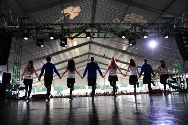 A troupe of Irish Dancers performing on stage at the Dublin Irish Festival.