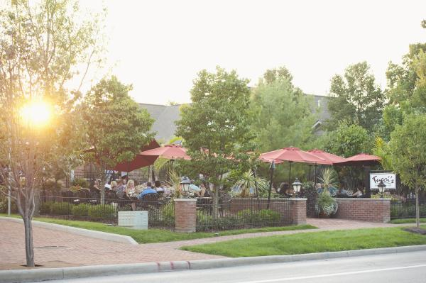 Tucci's outdoor dining patio at sunset.