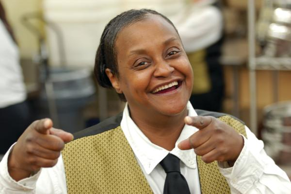 A Grand Wayne Convention Center employee cheerfully acknowledges the camera