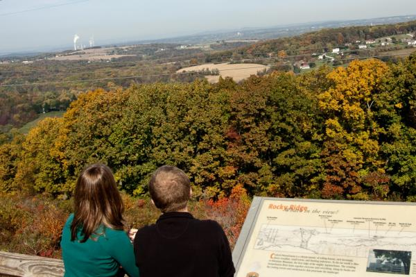 A couple enjoys the changing leaves at Rocky Ridge Park