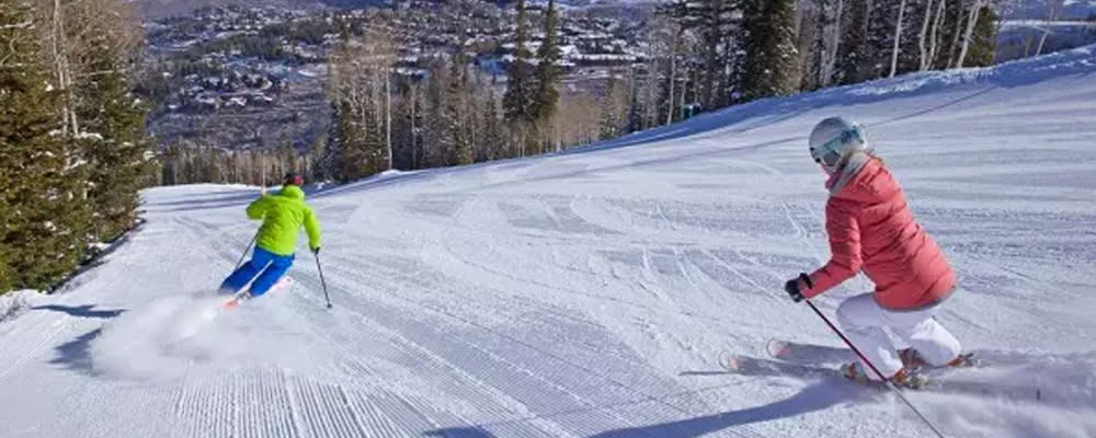 Spring Skiers going down the mountain in Park City