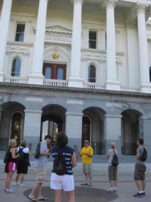 A group tour learns about the significance of the California State Seal at the Capitol.
