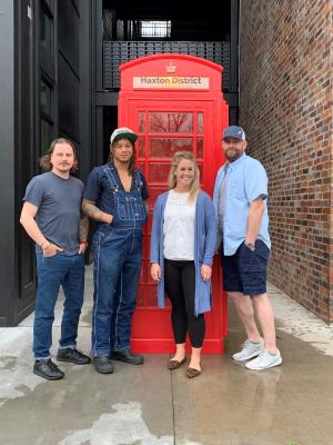 Chef Matt Cooper, head brewer Jay Means, Owner Anna Russel, and Owner Rob Nelson standing in front of Haxton Road Studios