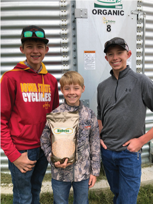Three brothers, from Rabou Farms display their wheat product from Rabros.