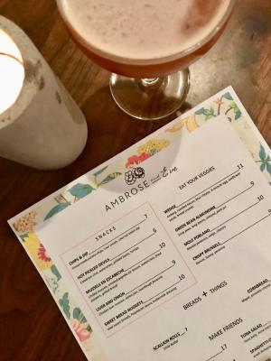 Floral-printed menu on table at Ambrose & Eve