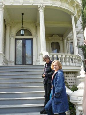 Janet and Carol climb the front steps of the California Governor's Mansion.