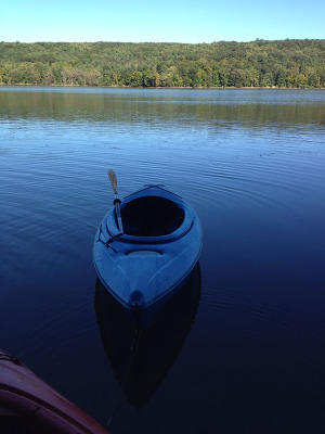 A kayak in the middle of getting launched into Canadice Lake