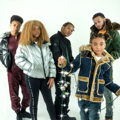 Five people wearing wintertime outerwear