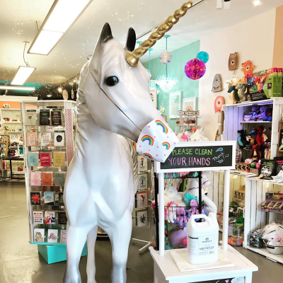 Unicorn Feed and Supply mascot wearing a mask
