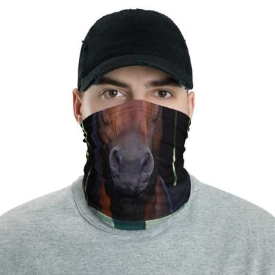 Man in black hat models a gaiter printed with the snout of a brown horse