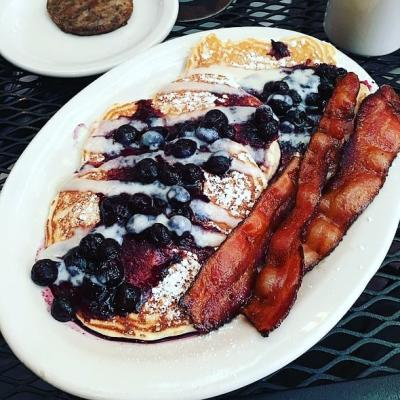 Lemon souffle blueberry pancakes and bacon from Toast on Market