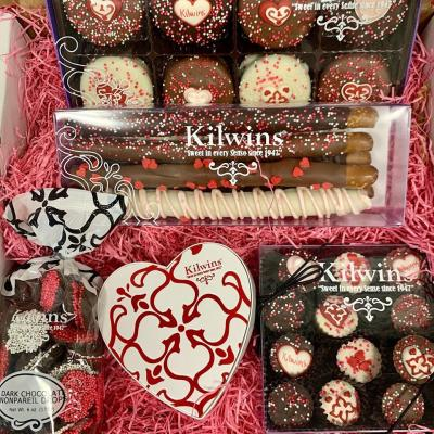 A box of assorted Valentine's themed candy from Kilwins