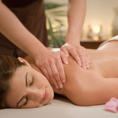 Woman getting a massage at the Woodhouse Day Spa