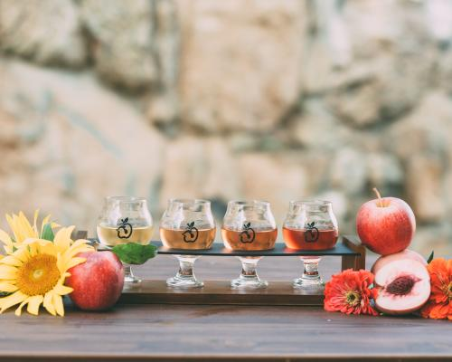 Henway Hard Cider flight with fall display