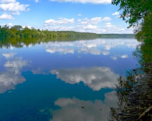 Algonkian Regional Park water reflections of the blue sky and clouds