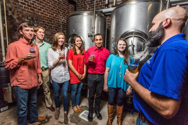 A group on a tour of the Macon Beer Brewing Company in Macon, GA