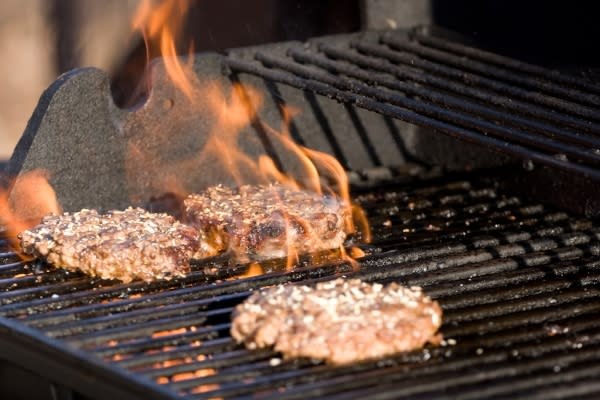 BBQ Grilling Hamburgers by Graphic Stock