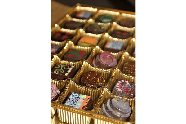 At Bruges Chocolaterie, artisan chocolates are hand painted by Culinarian Christina Miles.