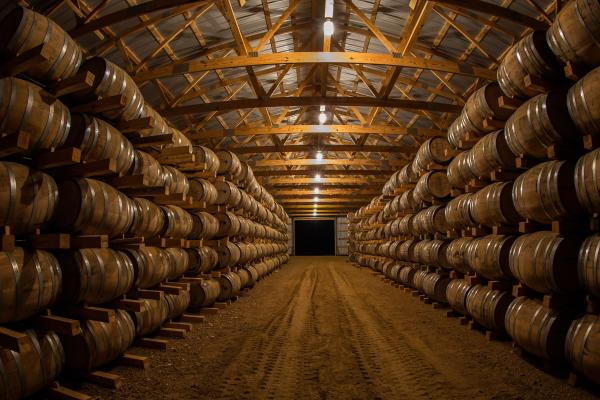 Barrel barn with walls of whiskey barrels
