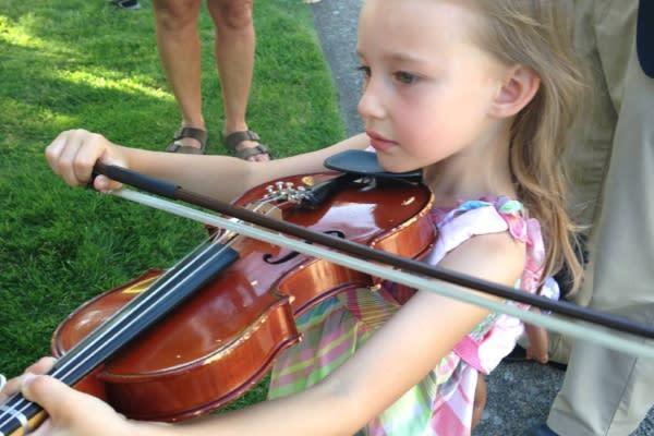 Playing the Violin by Taj Morgan