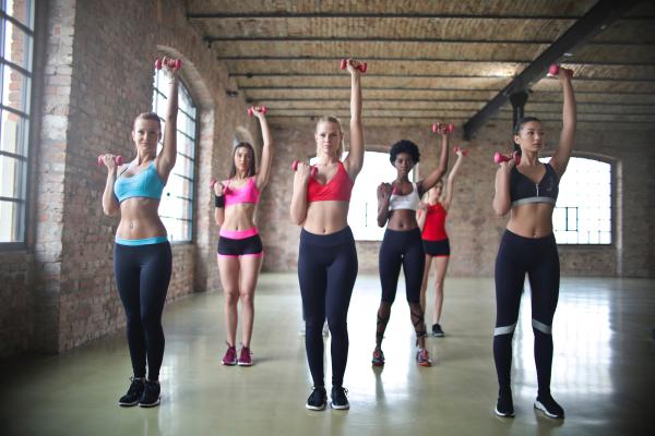 Women work out in SoIN aerobics class