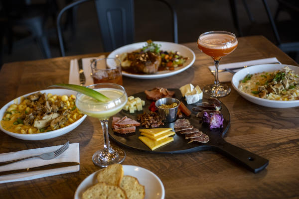 Dining Table Full of Food at Three Rivers Distilling Company in Fort Wayne, Indiana for Savor Fort Wayne